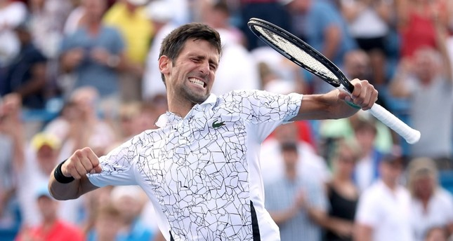Novak Djokovic of Serbia celebrates his win over Roger Federer of Switzerland during the men's final of the Western & Southern Open at Lindner Family Tennis Center in Mason, Ohio, Aug. 19, 2018. (AFP Photo)