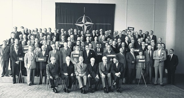 NATO parliamentarians pose for a photo in the first NATO Parliamentarians' Conference, later known as the North Atlantic Assembly, Paris, France, July 18, 1955.