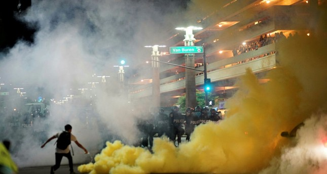Police use tear gas to disperse demonstrators after a Trump campaign rally in Phoenix, Arizona, Aug. 22.