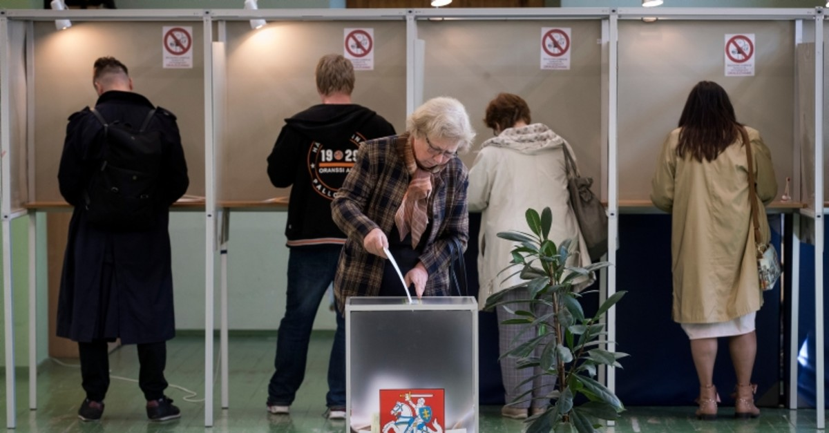 A woman cast her ballot during the first round of voting in presidential elections in Vilnius, Lithuania, Sunday May 12, 2019. (AP Photo)