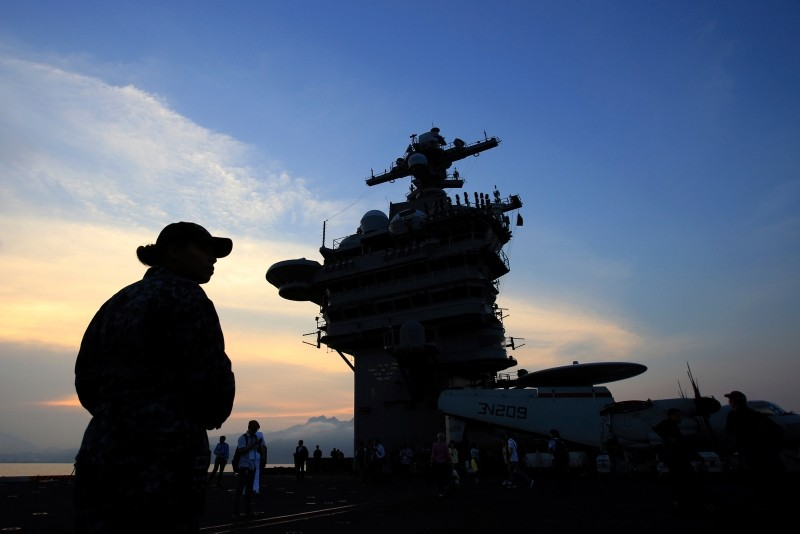 In this Monday, March 5, 2018 file photo, people stand on the deck of the USS Carl Vinson aircraft carrier as it docks in Danang bay, Vietnam (AP File Photo)