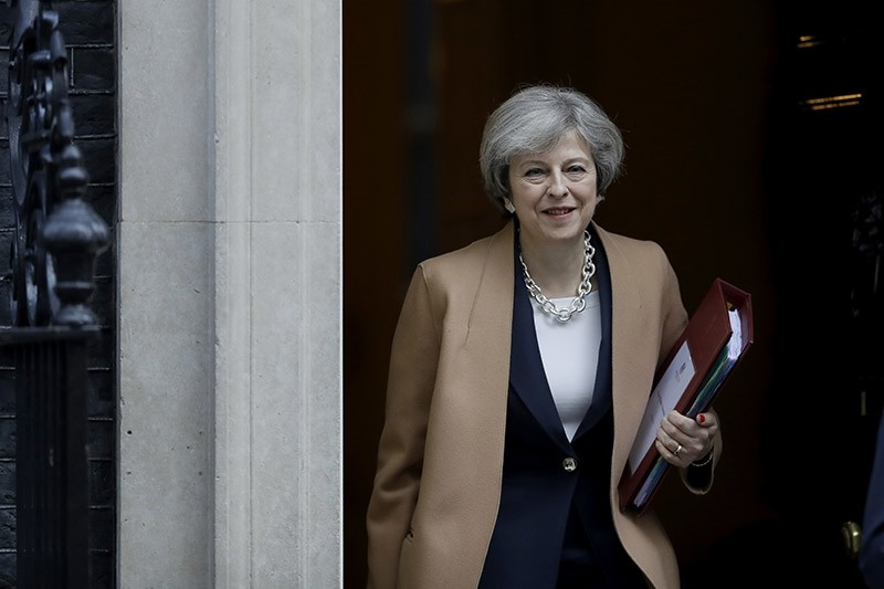 British Prime Minister Theresa May leaves 10 Downing Street in London, to attend Prime Minister's Questions at the Houses of Parliament, Wednesday, March 15, 2017. (AP Photo)