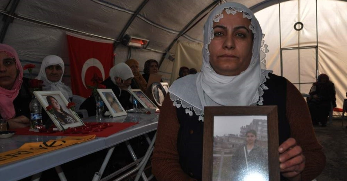 A Kurdish mother protesting PKK holds picture of her daughter abducted by the terrorist group, Jan.14, 2020. (DHA PHOTO)