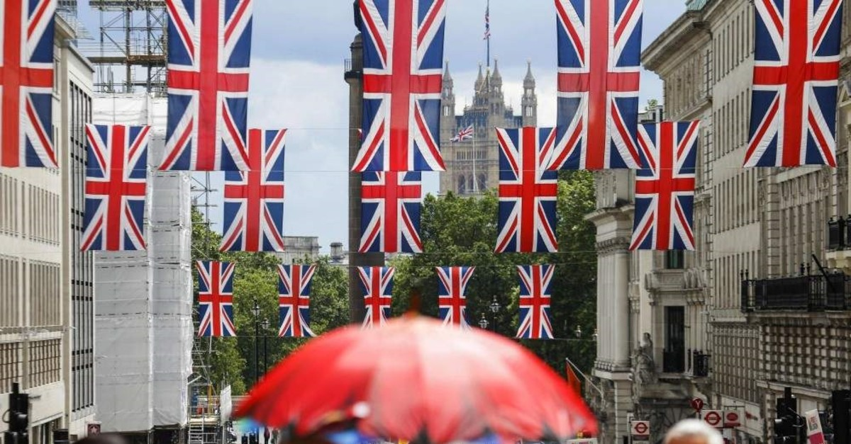 Union flag banners hang across a street near the Houses of Parliament, London, June 25, 2016. (AFP Photo)