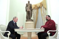 Putin presents Hollywood actor and martial arts expert Steven Seagal with Russian passport