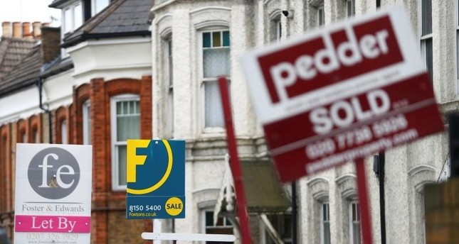 Estate agents boards are lined up outside houses in south London June 3, 2014 (Reuters File Photo)