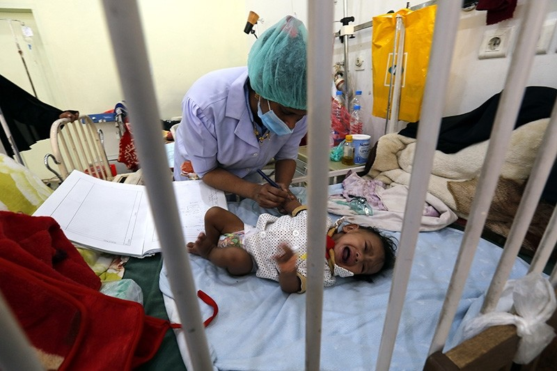 A Yemeni doctor treats a malnourished child amid worsening malnutrition, at a hospital in Sana'a, Yemen, Oct. 04, 2017. (EPA Photo)