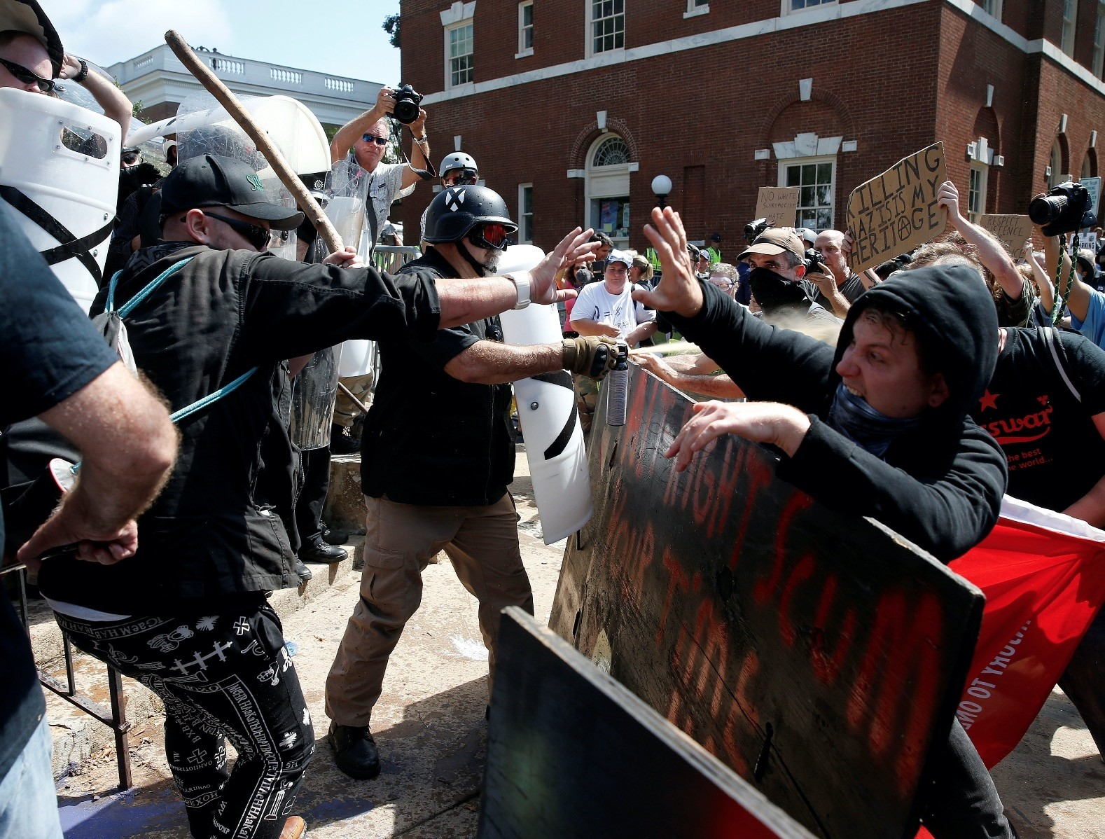 White nationalists, neo-Nazis and members of the u2018alt-rightu2019 clash with counter-protesters as they enter Lee Park during the u2018Unite the Rightu2019 rally Aug.12 in Charlottesville, Virginia.