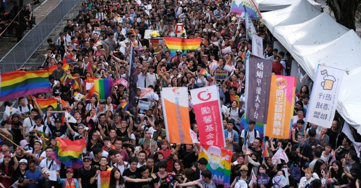 Same-sex marriage supporters celebrate after Taiwan became the first place in Asia to legalize same-sex marriage, outside the Legislative Yuan in Taipei, Taiwan May 17, 2019. (Reuters Photo)