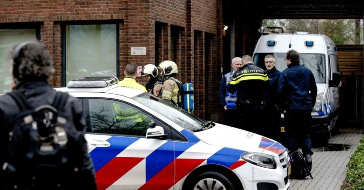 Police and emergency personnel gather during the investigation of a suspicious letter that was delivered to Unisys Payment Services in Leusden, Feb. 13, 2020. (Photo by Sander KONING / ANP / AFP) / Netherlands OUT