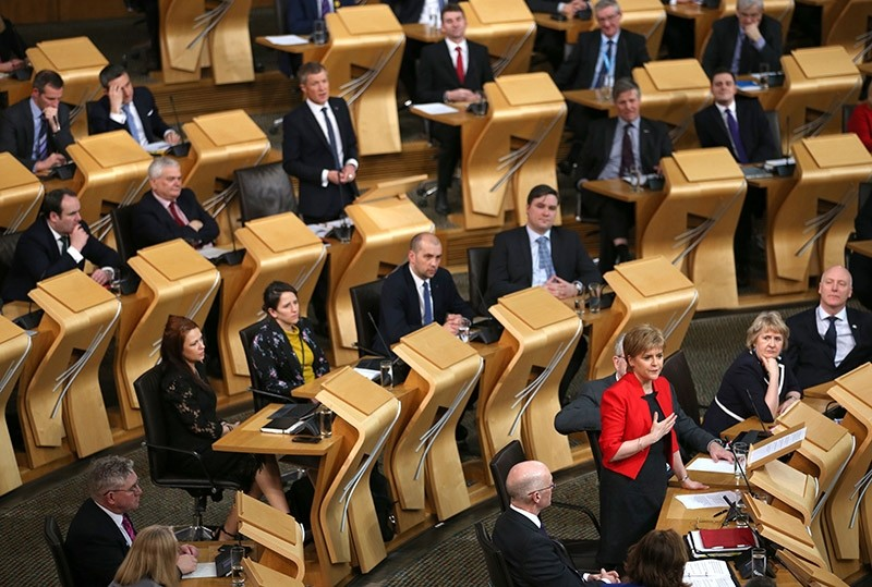 Scotland's First Minister Nicola Sturgeon speaks in the chamber on the first day of the 'Scotland's Choice' debate at the Scottish Parliament in Edinburgh on March 21, 2017. (AFP Photo)