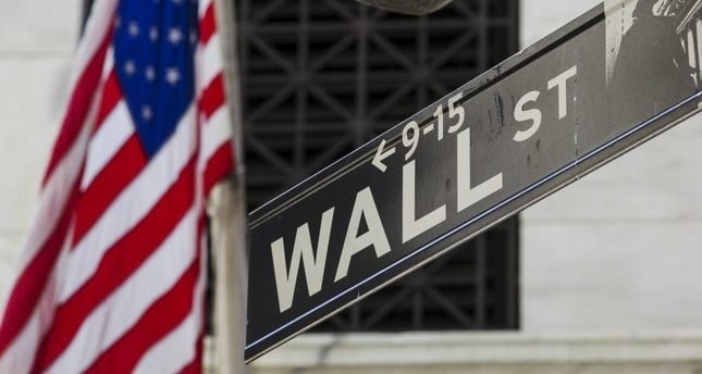 Wall Street closes higher with oil gains