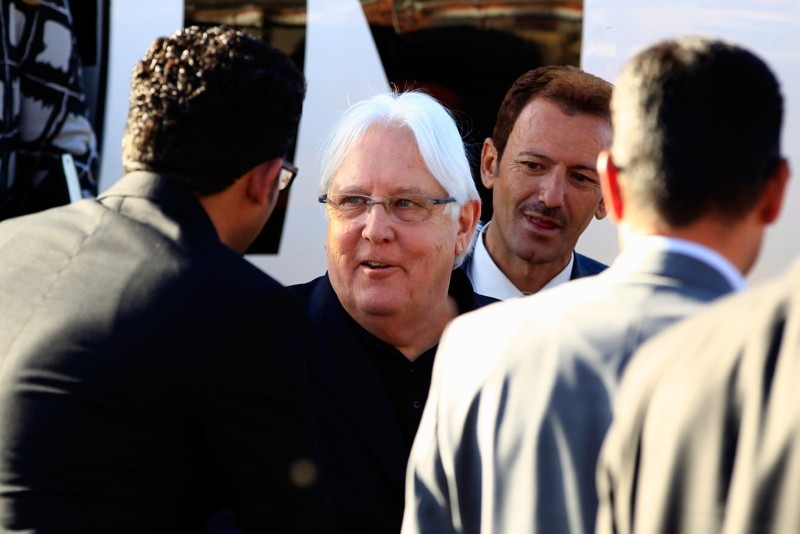 Martin Griffiths (C), the UN special envoy for Yemen, descends from his plane upon his arrival at Sanaa international airport on January 5, 2019.  (AFP Photo)