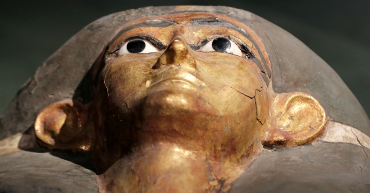 The face of a Pharaonic sarcophagus painted in gold on display at the Sohag National Museum, Sohag, Egypt April 6, 2019. (Reuters Photo)