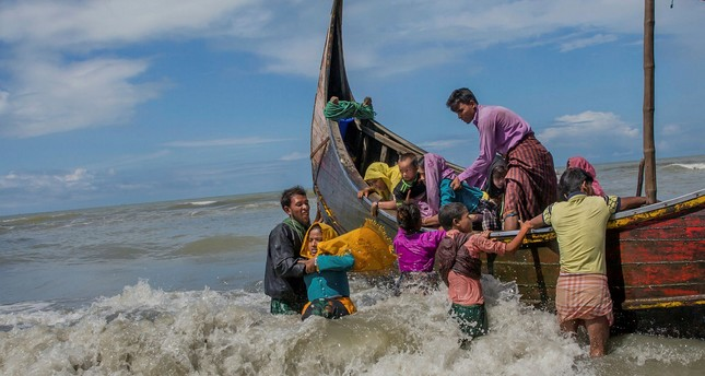 Rohingya refugees arrive on a boat from Myanmar to Bangladesh in Shah Porir Dwip, Sept. 14. 2017.
