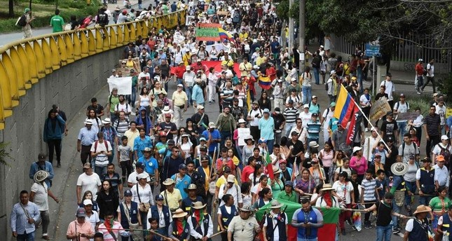 Anti-government protesters march in Medellin, Colombia, Dec. 4, 2019. AFP Photo