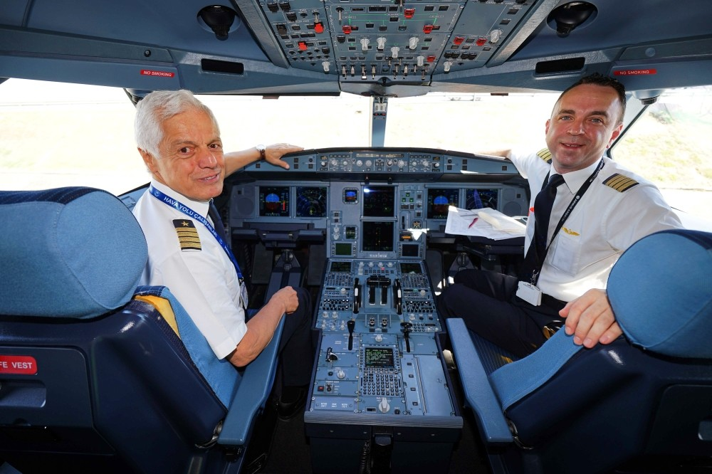 Turkish Airlines (THY) Captain Kemal u0130nce (L) was accompanied by his son u0130nanu00e7 u0130nce (R), also a THY pilot, during the final flight of his 45-year career.