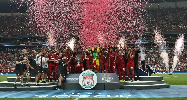 Liverpool's team poses with the trophy after winning the UEFA Super Cup 2019 football match between FC Liverpool and FC Chelsea at Beşiktaş's Vodafone Park stadium, Istanbul, Aug. 14, 2019.