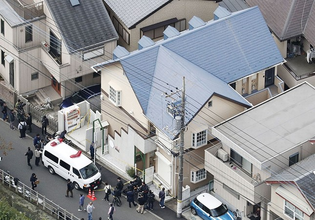 This aerial photo shows the apartment, center, where police found dismembered bodies in coolers in Zama city, southwest of Tokyo, Tuesday, Oct. 31, 2017. (Kyodo News via AP)