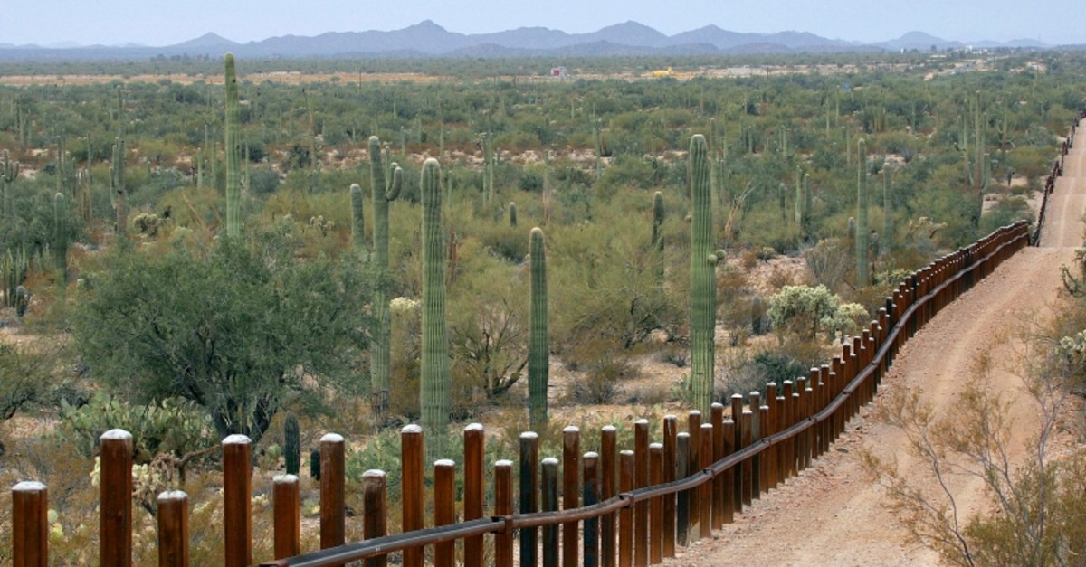 This Feb. 17, 2006 file photo shows the international border line made up of bollards: irregular, concrete-filled steel poles, seperating Mexico, left from the United States, in the Organ Pipe National Monument near Lukeville, Ariz. (AP Photo)