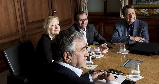 Northern Cyprus President Mustafa Akinci L faces Greek Cypriot leader Nicos Anastasiades R during Cyprus Peace Talks on November 20, 2016 in Switzerland. AP Photo