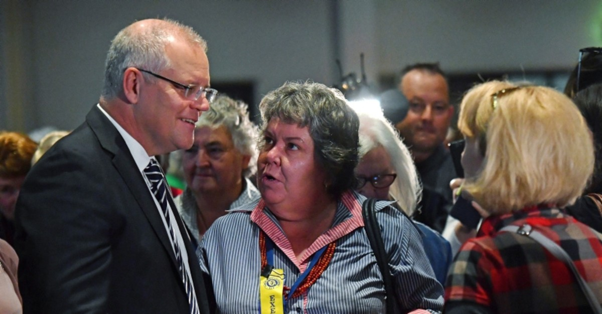 Australian Prime Minister Scott Morrison, left, talks with attendees at the Country Women's Association NSW annual conference in Albury, Tuesday, May 7, 2019 (AP Photo)
