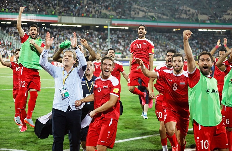 Players of Syria celebrate after the FIFA World Cup 2018 qualifying football match between Iran and Syria at the Azadi stadium in Tehran, Iran, Sept. 5 2017. (EPA Photo)