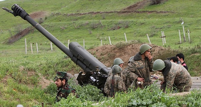 Armenian militias use heavy weapons to attack Azerbaijani military units in the disputed Nagorno-Karabakh region. (File Photo)