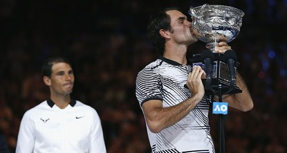 pRoger Federer defied age and his Grand Slam nemesis Rafael Nadal to win a record 18th Grand Slam title in a thrilling, five-set final at the Australian Open on Sunday./p