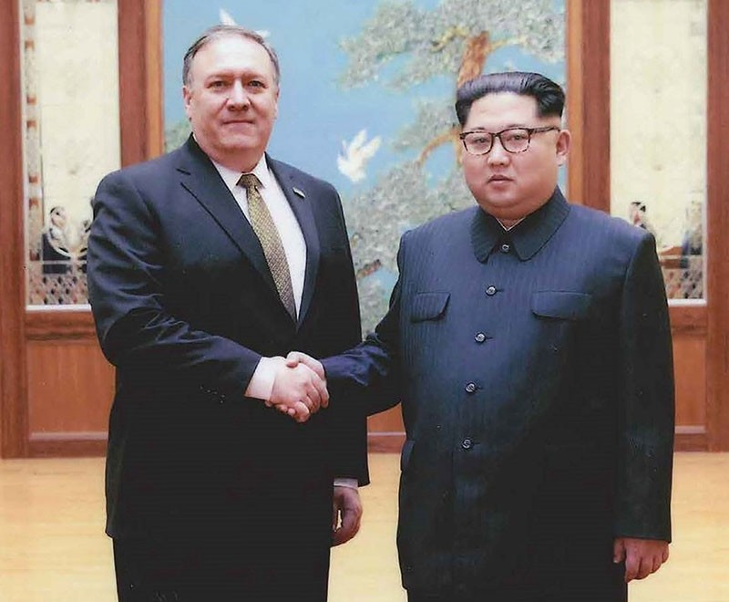 An undated handout photo made available by the US White House on April 26, 2018 shows then-CIA director Mike Pompeo (L) meeting with North Korean leader Kim Jong Un in, Pyongyang, North Korea (May 09, 2018).