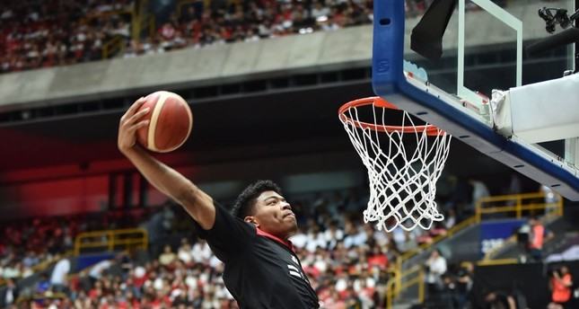Japan's Rui Hachimura warming up  before a basketball match between  Japan and Germany at Saitama  Super Arena, a venue for the Tokyo 2020 Olympic Games, Aug. 24, 2019.