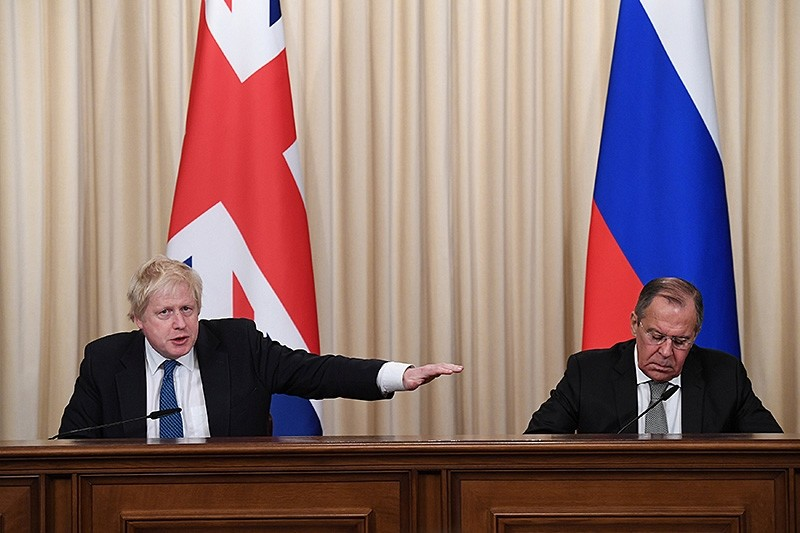 Britain's Foreign Secretary Boris Johnson and his Russian counterpart Sergei Lavrov hold a joint news conference following their meeting, in Moscow, Russia. (Reuters Photo)
