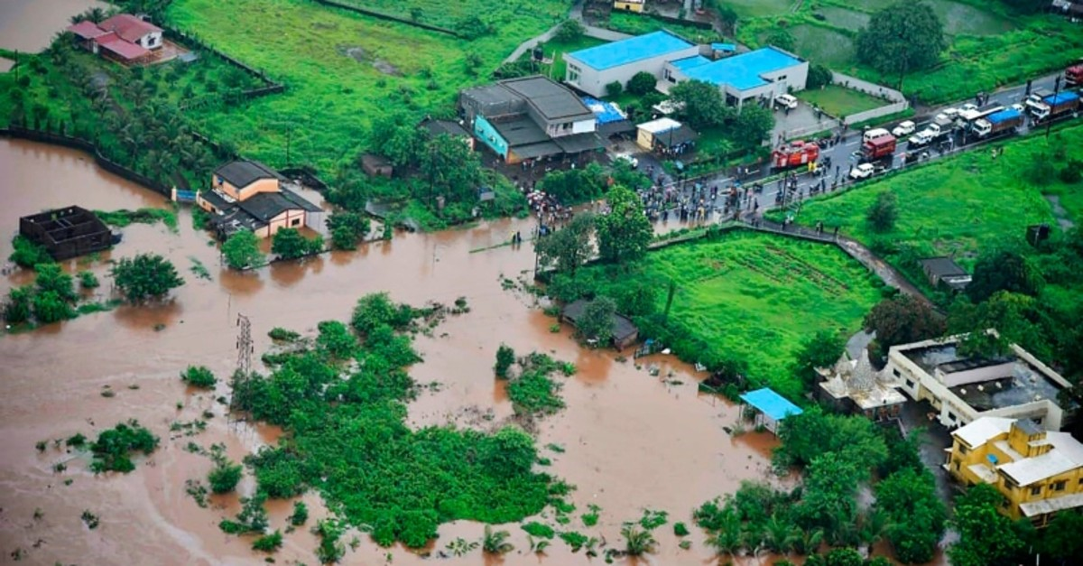 This handout photograph taken and released by the Indian Navy on July 27, 2019 shows an aerial view of a flooded area following heavy monsoon rains, in Badlapur some 70 kms from Mumbai. (AFP Photo)