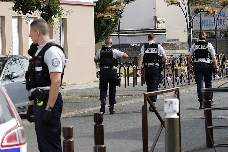 French police officers walk as two people have been detained after a possible explosives laboratory was discovered in Villejuif, south of Paris, Wednesday, Sept. 6, 2017 in Paris. (AP Photo)