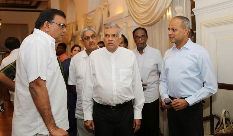 Sri Lanka's sacked prime minister Ranil Wickremesinghe, center, speaks with party members at his official residence in Colombo, Sri Lanka. (AP Photo)