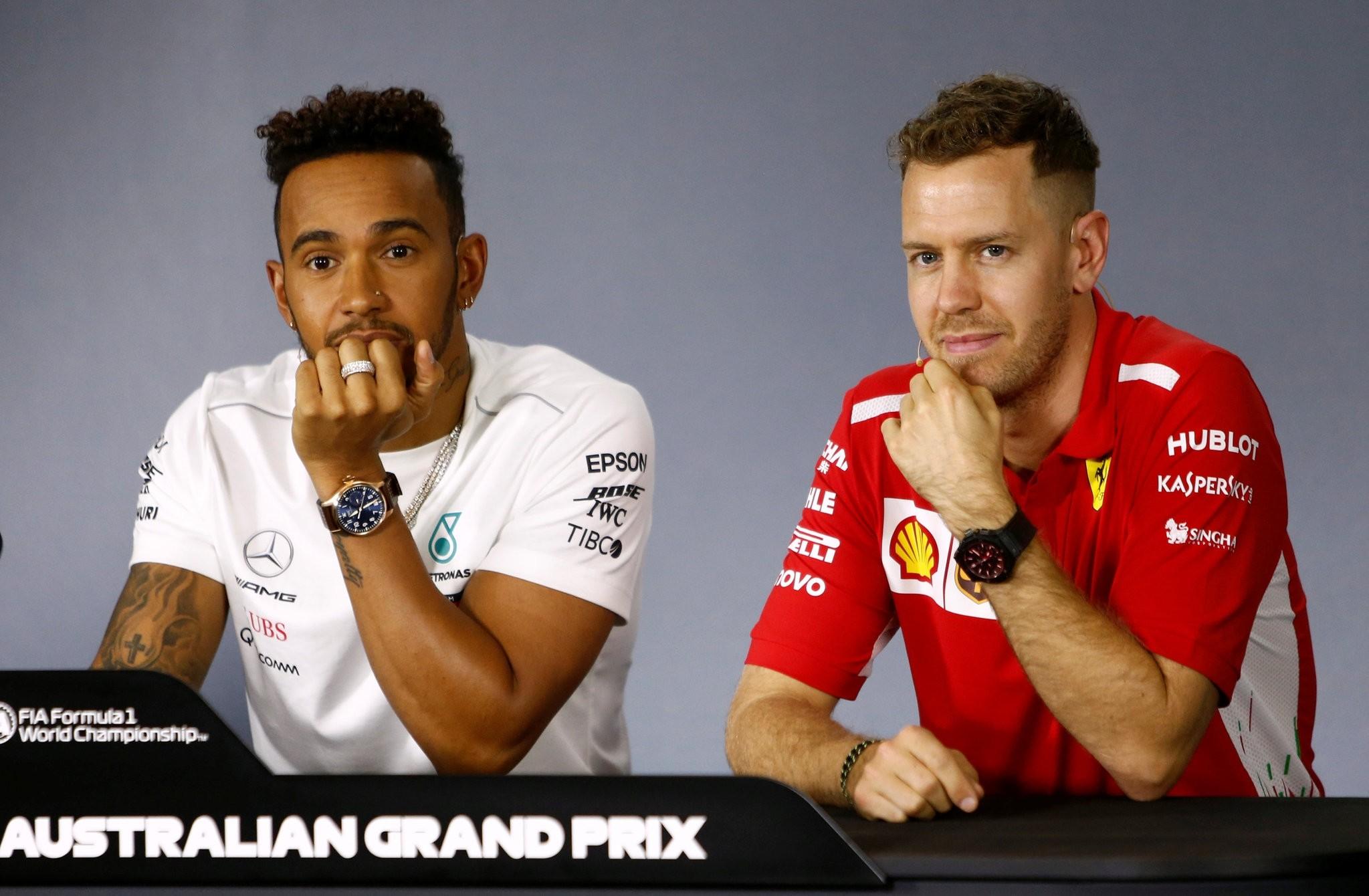 Mercedesu2019s British driver Lewis Hamilton (L) and Ferrariu2019s German driver Sebastian Vettel attend a press conference at the Albert Park circuit in Melbourne ahead of the Formula One Australian Grand Prix.
