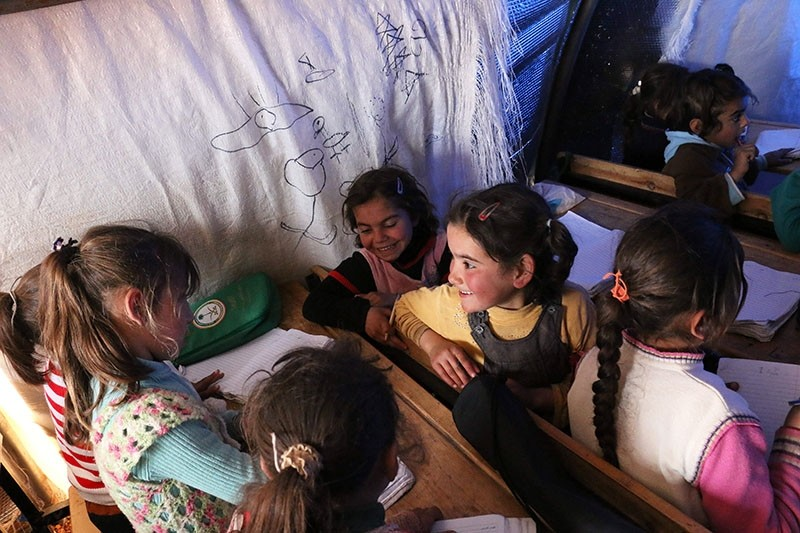 Displaced Syrian children attend a class at a makeshift camp in the Syrian city of Azaz, on March 23. (AFP Photo)