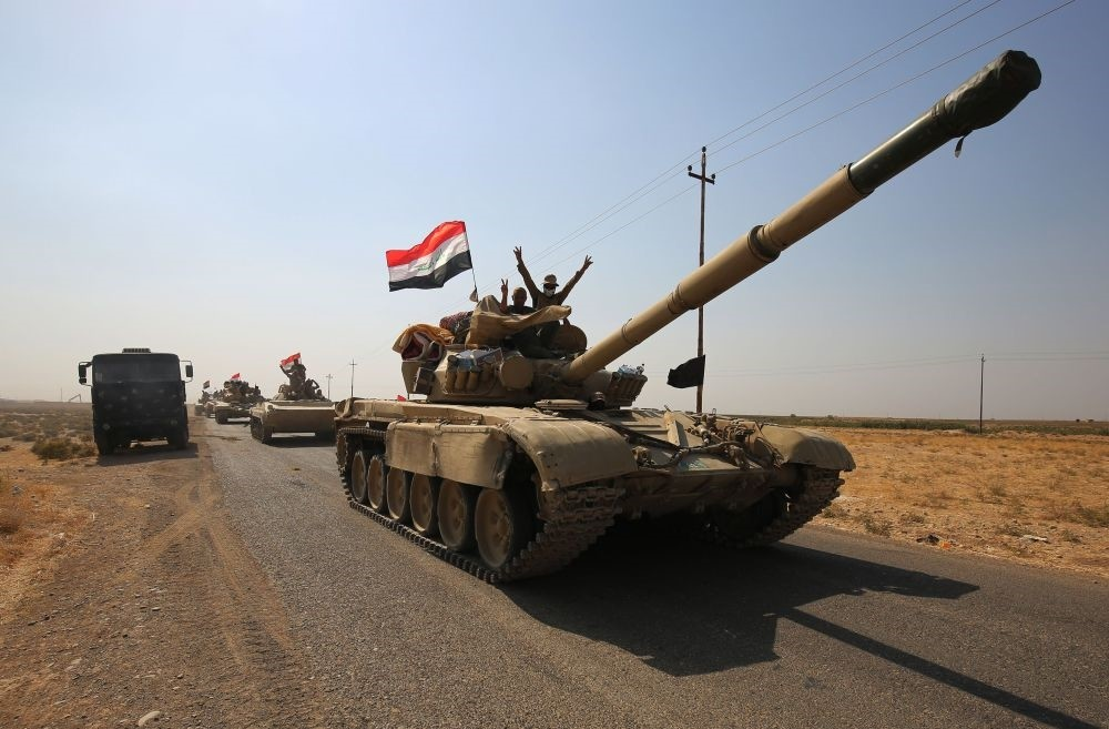 Iraqi forces drive toward KRG peshmerga positions on Oct. 15, on the southern outskirts of Kirkuk.
