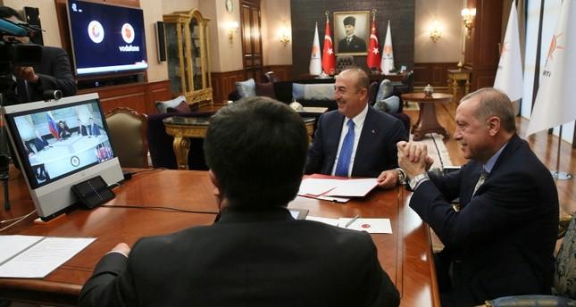 President Recep Tayyip Erdoğan (R) gestures as he speaks to Venezuela's President Nicolas Maduro during a conference call, in Ankara, Turkey, May 17, 2018. (AP Photo)