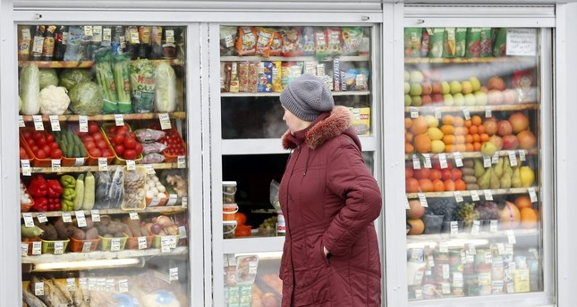 A Russian woman peers through the window to view fruits and vegetables at a street side market in Moscow. Ankara and Moscow have resumed free trade talks 10 months after jet crisis.