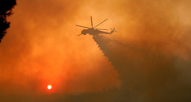 Hundreds of Greek firefighters battle wildfires near Athens