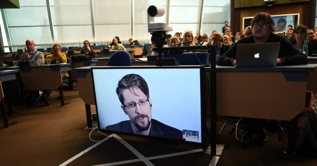 Edward Snowden speaks via video link from Russia as he takes part in a round table meeting on the subject of ,Improving the protection of whistleblowers,, at the Council of Europe in Strasbourg, eastern France (AFP Photo)