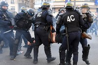 Paris police sprayed tear gas and arrested 13 demonstrators on Saturday at a rally meant to support a young black man who was severely beaten and raped with a police baton and other victims of...