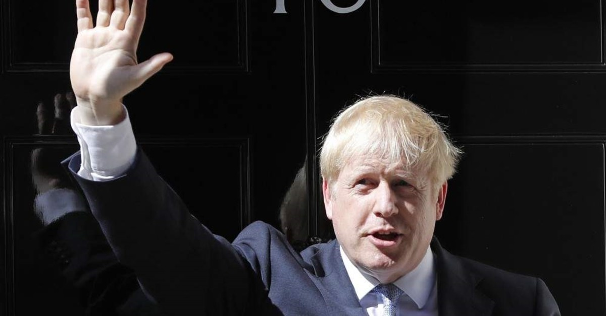 Britain's Prime Minister Boris Johnson waves from the steps outside 10 Downing Street, London, July 24, 2019. (AP Photo)