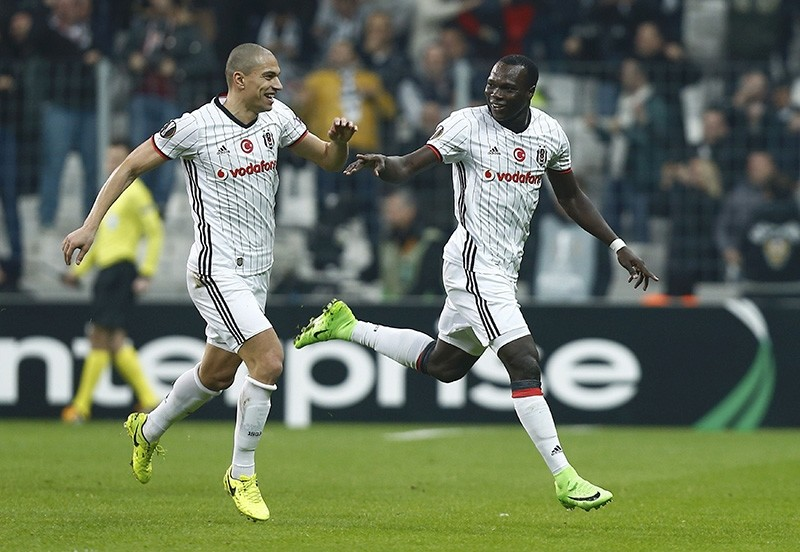 Gu00f6khan Inler and Vincent Aboubakar from Beu015fiktau015f react after scoring a goal against Hapoel Beer-Sheva in the UEFA Europa League Round of 32 Second Leg game at the Vodafone Arena, Istanbul, on Feb. 23, 2017. (Reuters Photo)