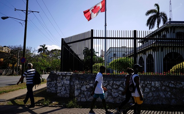 People pass by the Canada's Embassy in Havana, Cuba (Reuters Photo)