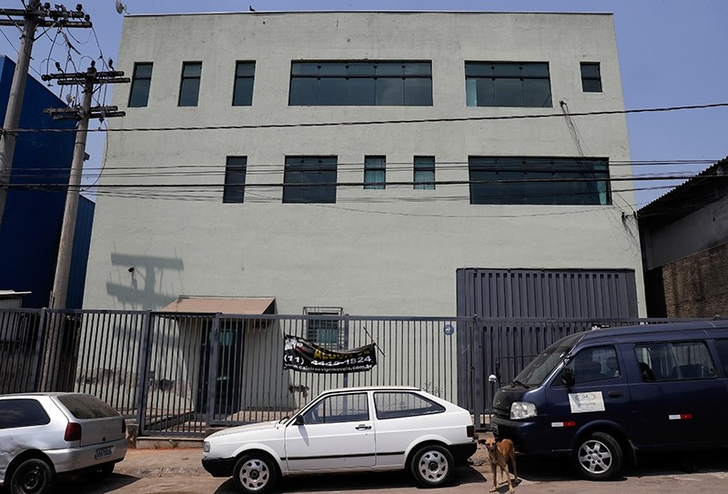 This Sept. 28, 2017 photo shows the facade of what once was the Stylofino picture frame factory owned by members of Rhema Community Evangelical Ministry, affiliated with the Word of Faith Fellowship church, in Franco da Rocha, Brazil (AP Photo)