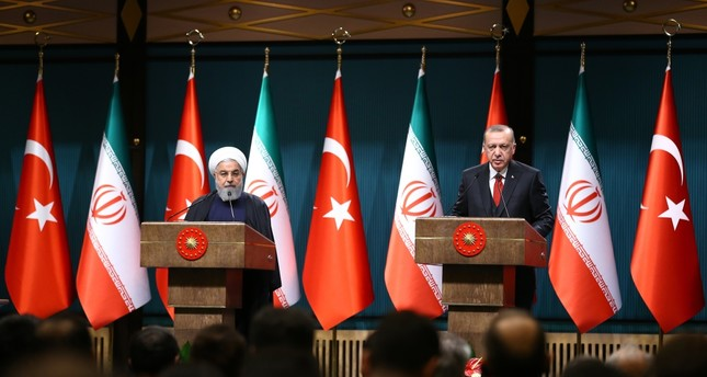 President Recep Tayyip Erdoğan (R) and his Iranian counterpart Hassan Rouhani hold a joint news conference after their meeting in Ankara yesterday.