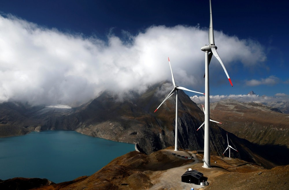 Wind turbines are pictured at Swisswinds farm in Gries, Switzerland. Governments are tapping the trend, selling green bonds to fund projects such as wind farms or low-carbon transport, with Poland, France and Nigeria making their debut this year.