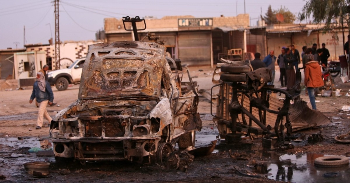 A picture taken on November 26, 2019 shows destroyed vehicles following a car bomb attack at a local market in the Turkish-held Syrian town of Tel Hal along the border with Turkey in the northeastern Hassakeh province, on Nov. 26, 2019. (AFP Photo)